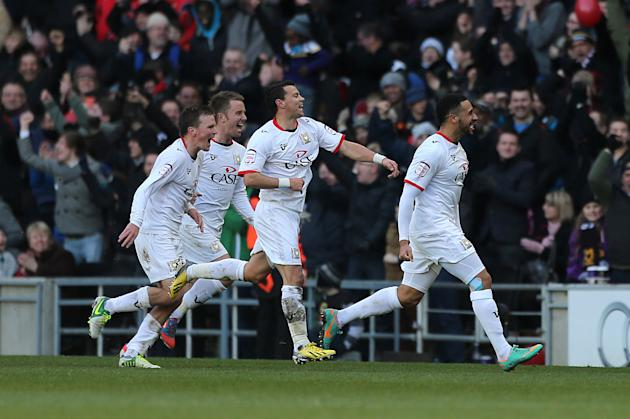 Jon Otsemobor, right, celebrates scoring the winner against AFC Wimbledon