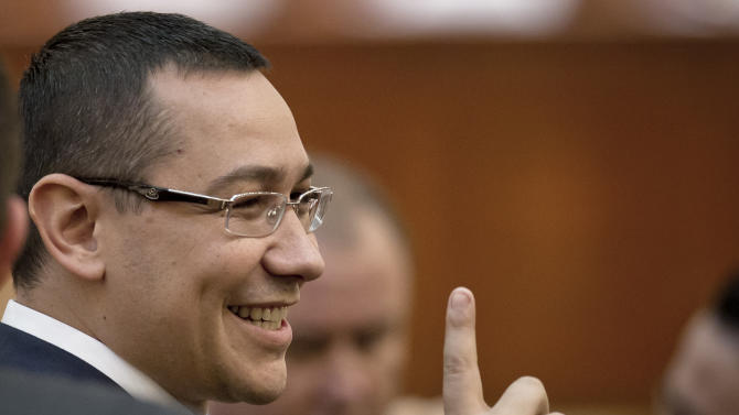 Romanian Premier designate Victor Ponta gestures before a parliament session in Bucharest, Romania, Monday, May 7, 2012. Romanian lawmakers are voting on whether to approve the prime minister designate's left-leaning Cabinet, which is expected to continue a slate of economic reforms. (AP Photo/Vadim Ghirda)