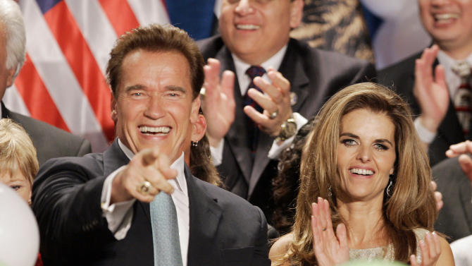 FILE - In this Nov. 6, 2006 file photo, Gov. Arnold Schwarzenegger celebrates with his wife Maria Shriver after giving his acceptance speech, in Beverly Hills, Calif. Maria Shriver has filed for divorce from Arnold Schwarzenegger in Los Angeles Superior Court, Friday, July 1, 2011.  (AP Photo/Mark J. Terrill, File)