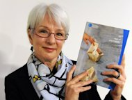 Australian Human Rights Commissioner Catherine Branson holds a report into Australia&#39;s treatment of Indonesian children it jailed as adults after they came as crew on people-smuggling boats, in Sydney on July 27, 2012. Branson said 180 Indonesians claimed to be under the age of 18 when they arrived in Australia between late 2008 and late 2011, but some were not believed and thrown in prison