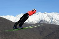 Simon Ammann competes during the Men's Ski Jumping Normal Hill Individual Official second Training at the RusSki Gorki Jumping Center on February 7, 2014 in Rosa Khutor near Sochi