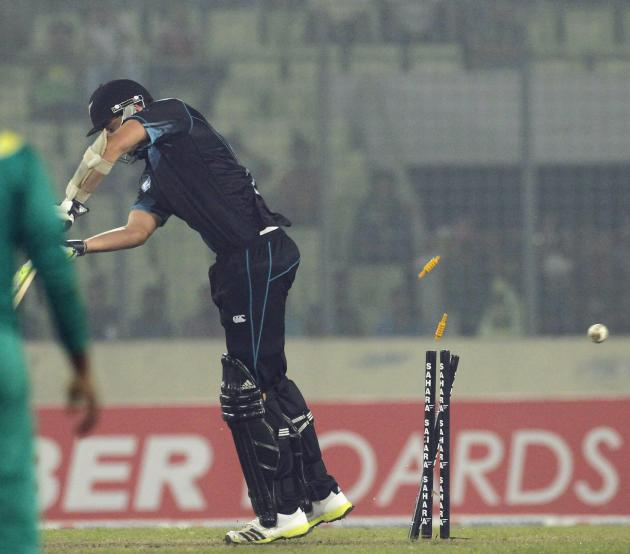 New Zealand's Mills is bowled out against Bangladesh during their second one-day international cricket match in Dhaka.