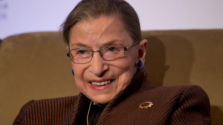 """Supreme Court Justice Ruth Bader Ginsburg smiles while speaking to the Northern Virginia Technology Council, Tuesday, Dec. 17, 2013, in Reston, Va. She took part in what event organizers describe as a """"fireside chat"""" with former U.S. Solicitor General Ted Olson. Olson served as solicitor general from 2001 to 2004 under President George W. Bush and is still a frequent advocate before the court. (AP Photo/Jacquelyn Martin)"""