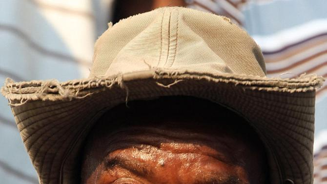 Miner reacts during their gathering in Lonmin Platinum Mine near Rustenburg, South Africa, Tuesday, Sept. 18, 2012. Striking miners have accepted a company offer of a 22% overall pay increase to end more than five weeks of crippling and bloody industrial action. (AP Photo/Themba Hadebe)
