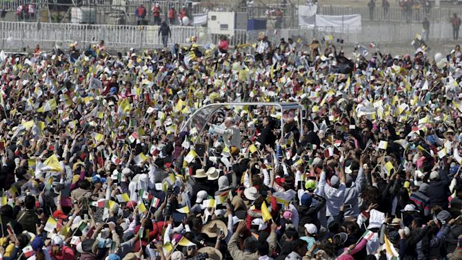 Pope Francis arrives to celebrate Mass for a crowd of hundreds of thousands in Ecatepec, Mexico,