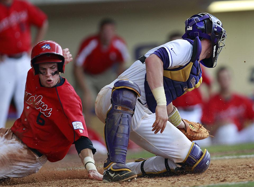 Stony Brook's Travis Jankowski (6) scores as he slides home behind LSU catcher Ty Ross (26) on a sacrifice fly by Kevin Krause in the 11th inning of an NCAA college baseball tournament super regional game in Baton Rouge, La., Friday, June 8, 2012. (AP Photo/Gerald Herbert)