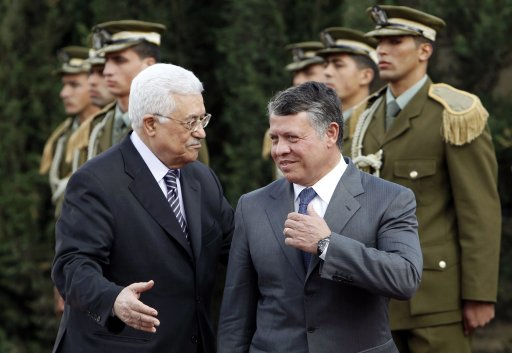 Palestinian President Abbas and King Abdullah of Jordan stand in front of honour guard during welcoming ceremony in Ramallah