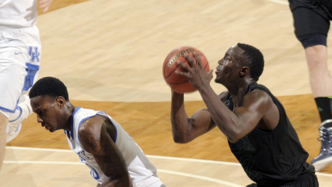 Notre Dame guard Jerian Grant, right, puts up a shot over Kentucky guard Archie Goodwin during the first half of an NCAA college basketball game Thursday, Nov. 29, 2012, in South Bend, Ind. (AP Photo/Joe Raymond)