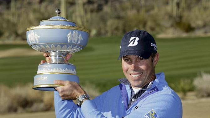 Matt Kuchar holds up the Walter Hagen Cup after defeating Hunter Mahan 2 and 1 in the final round of play during the Match Play Championship golf tournament, Sunday, Feb. 24, 2013, in Marana, Ariz. (AP Photo/Ted S. Warren)