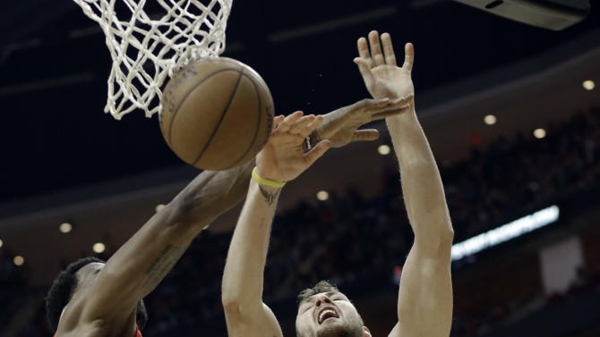 Houston Rockets' Donatas Motiejunas (20) is fouled by Los Angeles Clippers DeAndre Jordan, left, as Matt Barnes looks on in the second half of an NBA basketball game Friday, Nov. 28, 2014, in Houston. The Clippers won 102-85. (AP Photo/Pat Sullivan)