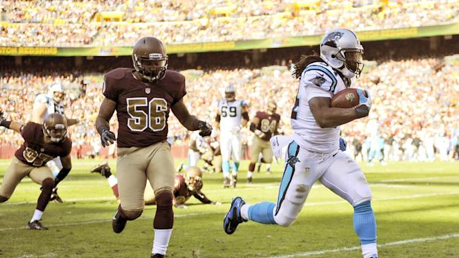 Carolina Panthers running back DeAngelo Williams (34) heads for a touchdown as he runs away from Washington Redskins inside linebacker Perry Riley (56) during the first half of an NFL football game Sunday, Nov. 4, 2012, in Landover, Md. (AP Photo/Nick Wass)