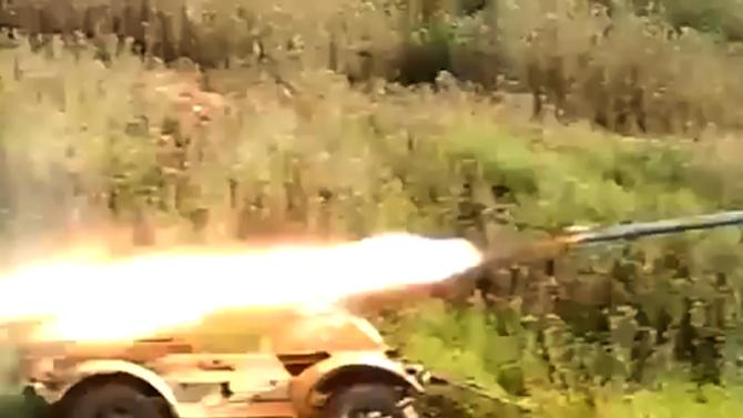 This image taken from video obtained from Ugarit News, which has been authenticated based on its contents and other AP reporting, shows a rocket fired by Syrian rebels at Mannagh air base in Aleppo province, Syria, Monday, May 13, 2013. The Syrian government wants more details before deciding whether to take part in a proposed U.S.-Russian initiative to negotiate a peaceful end to Syria's crisis, the country's information minister said, staking out a similar position to the main opposition group.(AP Photo/Ugarit News via AP video)