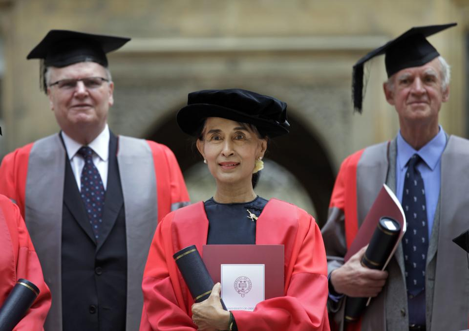 FILE - In this Wednesday, June 20, 2012 file photo, Myanmar opposition leader Aung San Suu Kyi, poses for the photographers following a ceremony for her honorary degree at Oxford University in Oxford, England. (AP Photo/Lefteris Pitarakis)