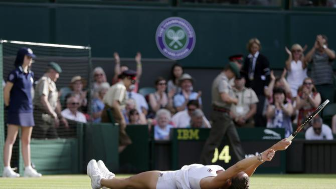 Jelena Jankovic of Serbia celebrates after winning her match against Petra Kvitova of the Czech Republic at the Wimbledon Tennis Championships in London