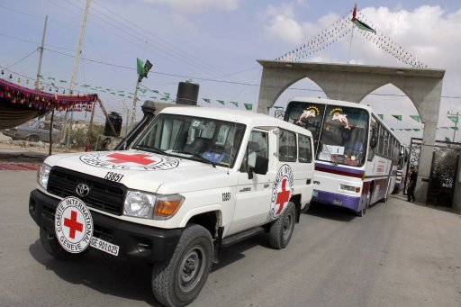 Buses and an International Red Cross vehicle arrive at the Rafah border crossing