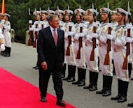 US Secretary of Defense Leon Panetta (C) reviews a naval honour guard during his visit to Qingdao before touring Chinese naval vessels of the North Sea Fleet, on September 20. Panetta got a rare first-hand look at the Chinese naval base, as Washington pushes security dialogue with a country that could rival US power in the Asia-Pacific