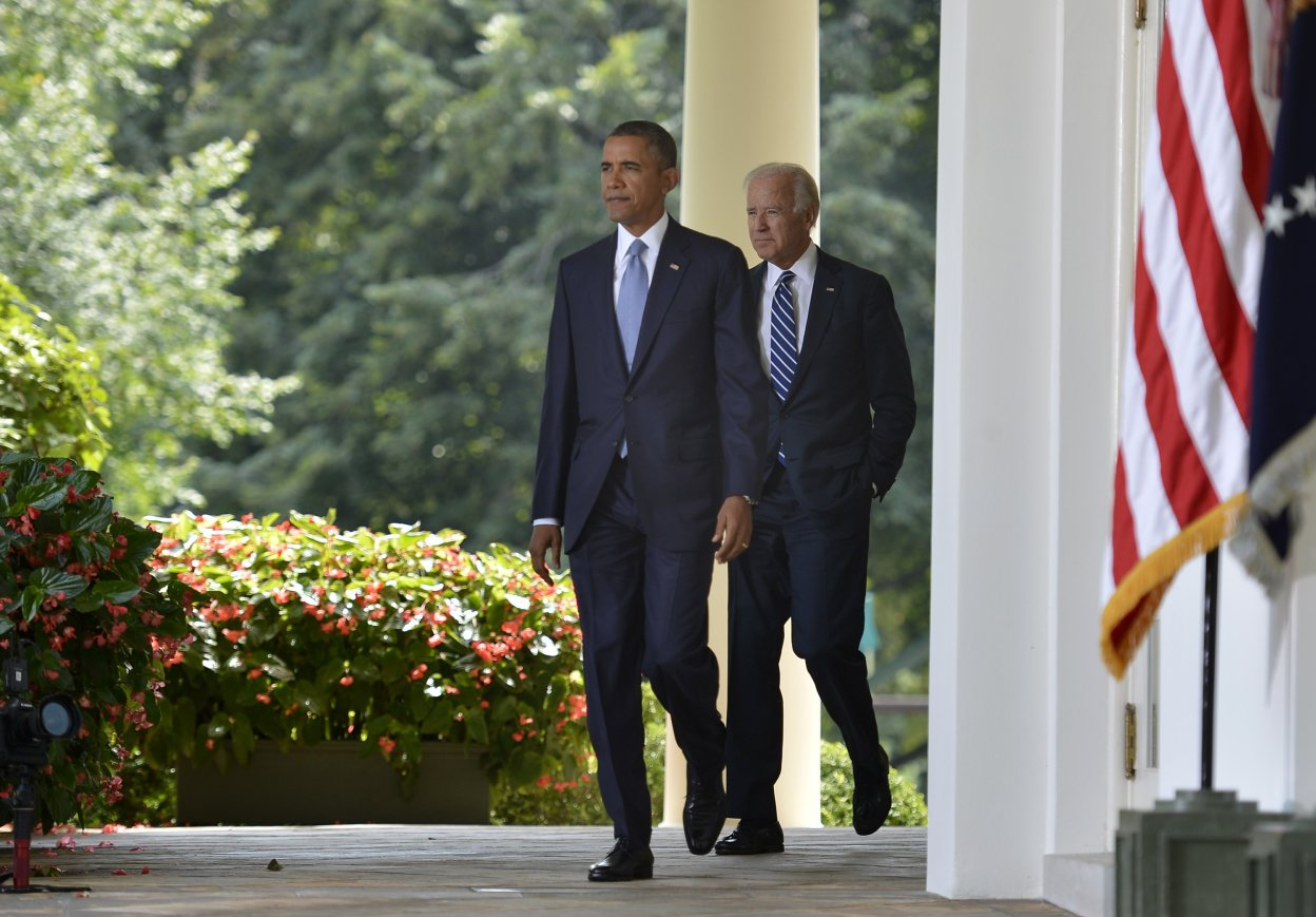 U.S. President Obama walks with Vice President Biden to the Rose Garden of the White House to make remarks on the situation in Syria
