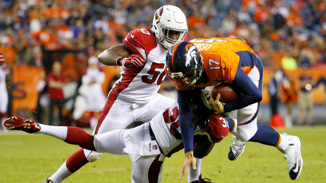 Denver Broncos quarterback Brock Osweiler (17) is hit by Arizona Cardinals defensive back C.J. Roberts (36) during the first half of an NFL preseason football game, Thursday, Sept. 3, 2015, in Denver. (AP Photo/Jack Dempsey)