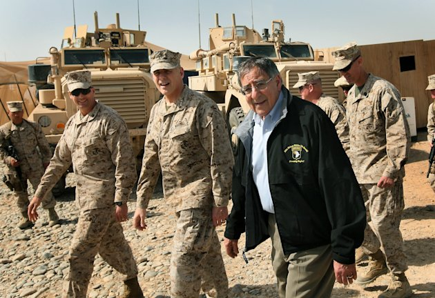 Defense Secretary Leon Panetta visits with troops at Forward Operating Base Shukvani, Afghanistan, Wednesday, March 14, 2012. Panetta is also scheduled to meet with President Karzai during his two-day visit to Afghanistan. (AP Photo by Scott Olson, Pool)