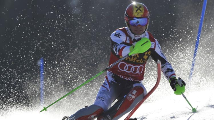 Hirscher of Austria clears a gate during the first run of the Alpine Skiing World Cup men's slalom ski race in Kranjska Gora