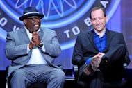 "FILE - This Aug. 4, 2013, file photo, shows game show host Cedric ""The Entertainer,"" left, and producer Rick Sirop of ""Who Wants To Be A Millionaire"" at the Disney/ABC Television Group's 2013 Summer TCA panel in Beverly Hills, Calif. On Sept. 2, the new season of ""Who Wants To Be A Millionaire"" premieres, ushering in Cedric ""The Entertainer"" as host. (Photo by Vince Bucci/Invision/AP, File)"
