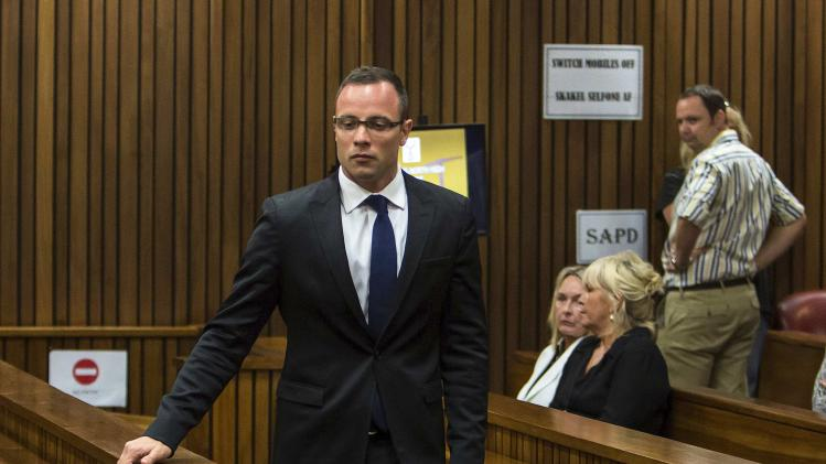 Olympic and Paralympic track star Pistorius arrives in court as Steenkamp's mother June looks on in the North Gauteng High Court in Pretoria