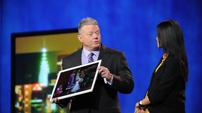 "CEO of Panasonic North America, Joe Taylor, and Lisa Ling debut the new Panasonic 20"" 4k Tablet computer at the International Consumer Electronics Show 2013, on Tuesday, January 8, 2013, Las Vegas, NV during the Panasonic Keynote presentation (Photo by Al Powers/Invision for Panasonic/AP Images)"
