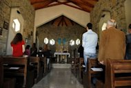 Villagers pray at a Catholic church in the village of Kravaseri in May 2012. Only about 50,000 of Kosovo&#39;s 1.7 million citizens are Catholics, while more than 90 percent of the population are Muslim