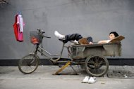 <p>A peddler rests on his trishaw in Beijing. China's industrial output growth weakened in August to its slowest pace in more than three years, official figures showed, confirming a deepening slowdown in the world's second-biggest economy.</p>
