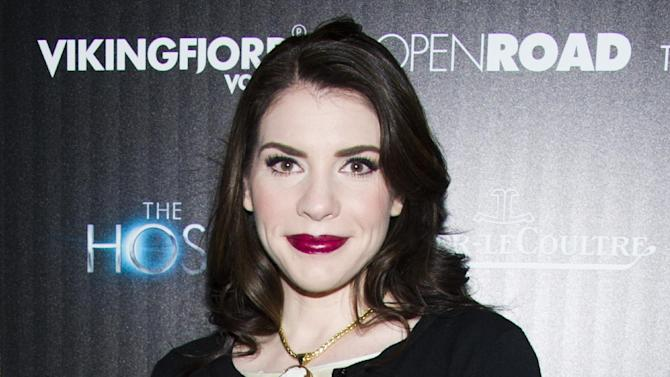 "FILE - This March 27, 2013 file photo shows author Stephenie Meyer at a screening of ""The Host"" in New York. On Wednesday, Hachette Book Group became the fourth major publisher this year to announce it was expanding its digital offerings to libraries. Hachette, whose authors include Stephenie Meyer and Malcolm Gladwell, will offer its entire e-catalog to libraries after two years of pilot programs. New books will be available simultaneously in paper and e-editions, a policy also recently adapted by Penguin Group (USA). Hachette, Penguin and other publishers had previously restricted newer works out of concern for lost sales. (Photo by Charles Sykes/Invision/AP, file)"