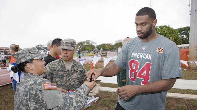 Cincinnati Bengals tight end Jermaine Gresham (84) of the AFC signs autographs during NFL Pro Bowl Practice at Joint Base Pearl Harbor Hickam, Thursday, Jan. 24. 2013 in Honolulu.  (Marco Garcia/AP Images for USAA)