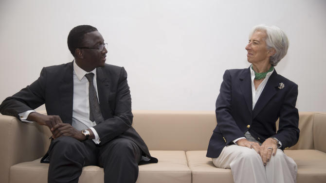 IMF Managing Director Christine Lagarde meets with Senegal's Finance Minister Amadou Ba at the airport upon her arrival in Dakar