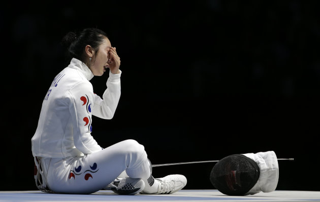 South Korea's Shin A-lam waits for an appeal to an officials decision after a women's individual epee fencing semifinals match against Germany's Britta Heidemann at the 2012 Summer Olympics, Monday, July 30, 2012, in London. (AP Photo/Andrew Medichini)