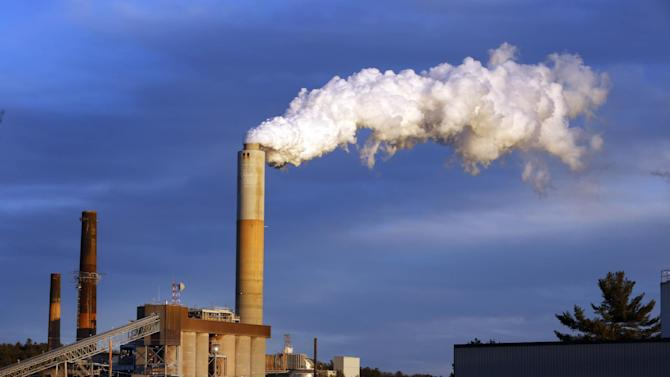 FILE - In this Jan. 20, 2015 file photo, a plume of steam billows from the coal-fired Merrimack Station in Bow, N.H. President Barack Obama presented his final plan for carbon dioxide reduction targets on Monday, Aug. 3, 2015, which would reduce emissions 32 percent below 2005 levels by 2030. (AP Photo/Jim Cole, File)