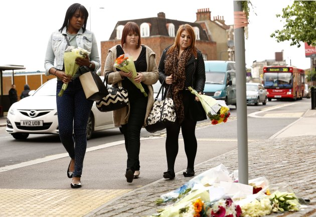Women prepare to lay flowers near the scene of the killing of a British soldier in Woolwich, southeast London