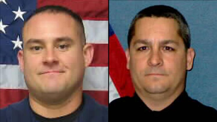 This combination of undated photos provided by the Topeka, Kan., Police Department shows Officer Jeff Atherly, left, 29, and Cpl. David Gogian, 50, who were fatally shot outside a Topeka grocery store Sunday, Dec. 16, 2012 while responding to a report of a suspicious vehicle, authorities said. Authorities say a man suspected in the fatal shooting of Atherly and Gogian has died after an armed standoff with law enforcement at a house in Topeka, Kan.  (AP Photo/Topeka Police Department)