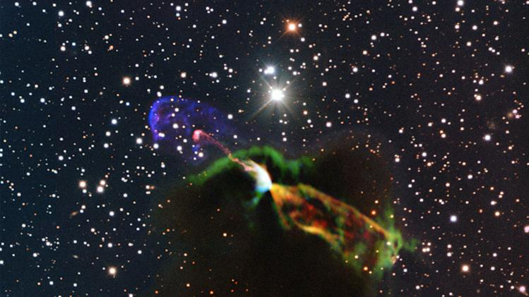 This image made available by the European Southern Observatory on Tuesday, Aug. 20, 2013 using radio and visible light frequencies shows the Herbig-Haro object HH 46/47. The orange and green, lower right, of the newborn star reveal a large energetic jet moving away from the Earth, which in the visible is hidden by dust and gas. To the left, in pink and purple, the visible part of the jet is seen, streaming partly towards the Earth. Astronomers say these illuminated jets from the newborn star are spewing out faster than ever measured before and are more energetic than previously thought. (AP Photo/ESO/ALMA (ESO/NAOJ/NRAO)/H. Arce, Bo Reipurth)