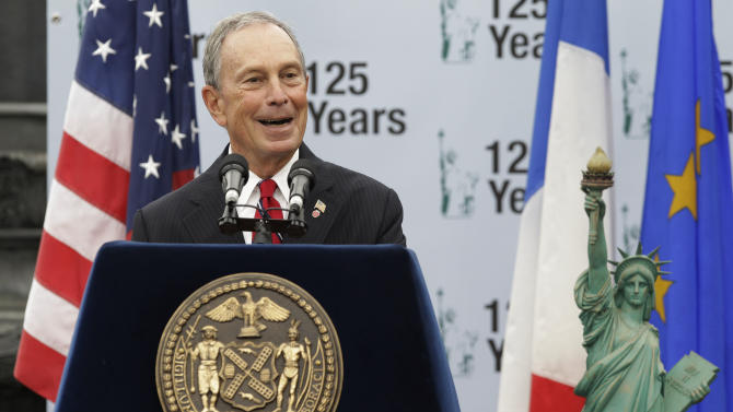 New York Mayor Michael Bloomberg addresses the crowd during a visit to Liberty Island in anticipation of the 125th Anniversary of the Statue of Liberty, Thursday, Sept. 22, 2011, in New York. The statue's anniversary is Oct. 28. (AP Photo/Julio Cortez)