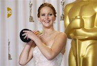 "Jennifer Lawrence, best actress winner for her role in ""Silver Linings Playbook,"" poses with her Oscar backstage at the 85th Academy Awards in Hollywood, California, February 24, 2013. REUTERS/Mike Blake"