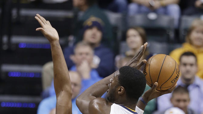 Indiana Pacers' Roy Hibbert (55) shoots against Miami Heat's Chris Bosh during the first half of an NBA basketball game Tuesday, Jan. 8, 2013, in Indianapolis. (AP Photo/Darron Cummings)