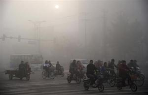 Residents ride bicycles amid heavy haze in Xingtai