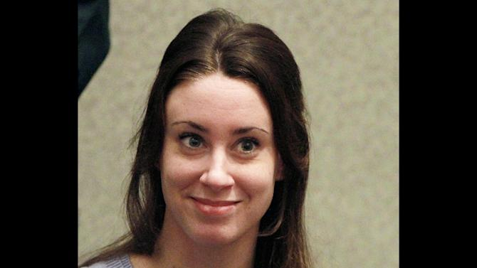 FILE - In this July 7, 2011 file photo, Casey Anthony smiles before the start of her sentencing hearing in Orlando, Fla. A Florida appellate court on Friday, Jan. 25, 2012 set aside two of the four convictions Anthony faced for lying to detectives during the investigation into her missing 2-year-old daughter, Caylee. Anthony was acquitted of killing Caylee in 2011. Jurors convicted her of four counts of lying to detectives, and her attorneys appealed those convictions. Anthony was sentenced to time served for the misdemeanors. Judges on the 5th District Court of Appeals agreed with Anthony's attorneys that two of the charges constituted double jeopardy, or being convicted more than once for the same crime. (AP Photo/Joe Burbank, Pool, File)