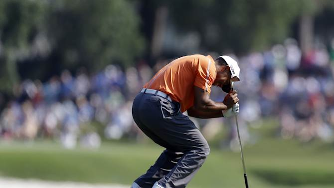 Tiger Woods reacts to his shot from the 11th fairway during the first round of The Players Championship golf tournament at TPC Sawgrass, Thursday, May 9, 2013, in Ponte Vedra Beach, Fla. (AP Photo/John Raoux)