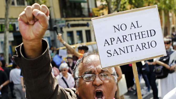 An Immigrant holds a banner reading