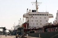 File photo shows ships docked at Iran&#39;s Imam Khomeini port in Mahshahr. The side-effects of US sanctions on companies buying oil from Iran include a cutoff in fuel supplies to Iran Air and shipping companies&#39; reluctance to call on Iranian ports