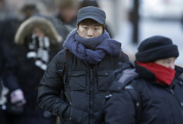 Commuters bundle up against extreme cold conditions Tuesday, Jan. 22, 2013, in Chicago. Temperatures in the area were hovering around zero with sub-zero wind chill reading hitting 10 below. Forecaster