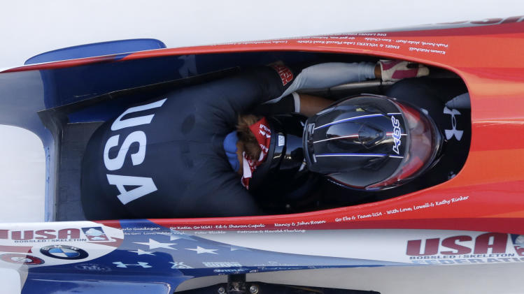 USA's pilot Jazmine Fenlator with brakewoman Lolo Jones races to a second-place finish in the women's bobsled World Cup competition on Friday, Nov. 9, 2012, in Lake Placid, N.Y. (AP Photo/Mike Groll)