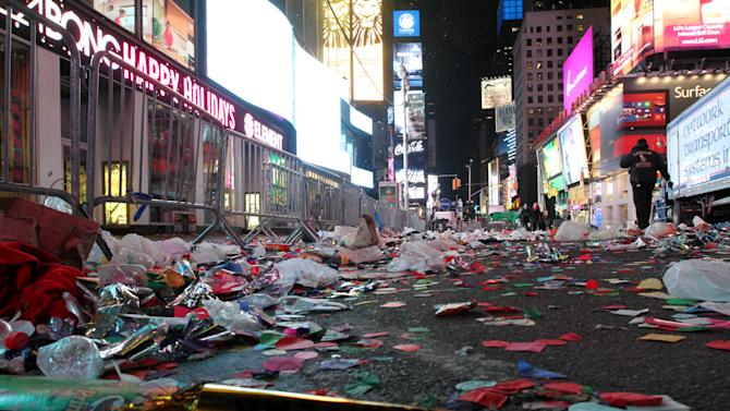 Confetti and other items from the New Year's festivities litters the street in New York's Times Square early Tuesday morning Jan. 1, 2013. (AP Photo/Tina Fineberg)