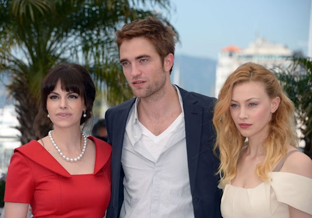 Emily Hampshire, Robert Pattinson and Sarah Gadon pose at the