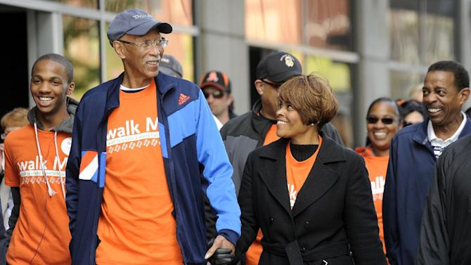 FILE - In this April 29, 2012 file photo Detroit Mayor Dave Bing, 2nd from left, and his wife Yvette Bing take part in the Walk MS event at Comerica Park in Detroit. The former NBA great, who transitioned smoothly to owner and founder of a steel supply company, became Mayor of Detroit in 2009.  In basketball and business, he never side-stepped a challenge, but the overwhelming weight of Detroit's financial problems and other troubles have convinced Bing to pass control of the city over to the state. (AP Photo/The Detroit News, David Coates, File)